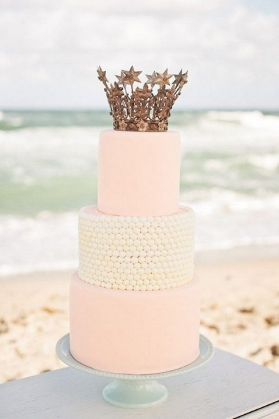 pink-wedding-cake-with-crown-cake-topper.jpg