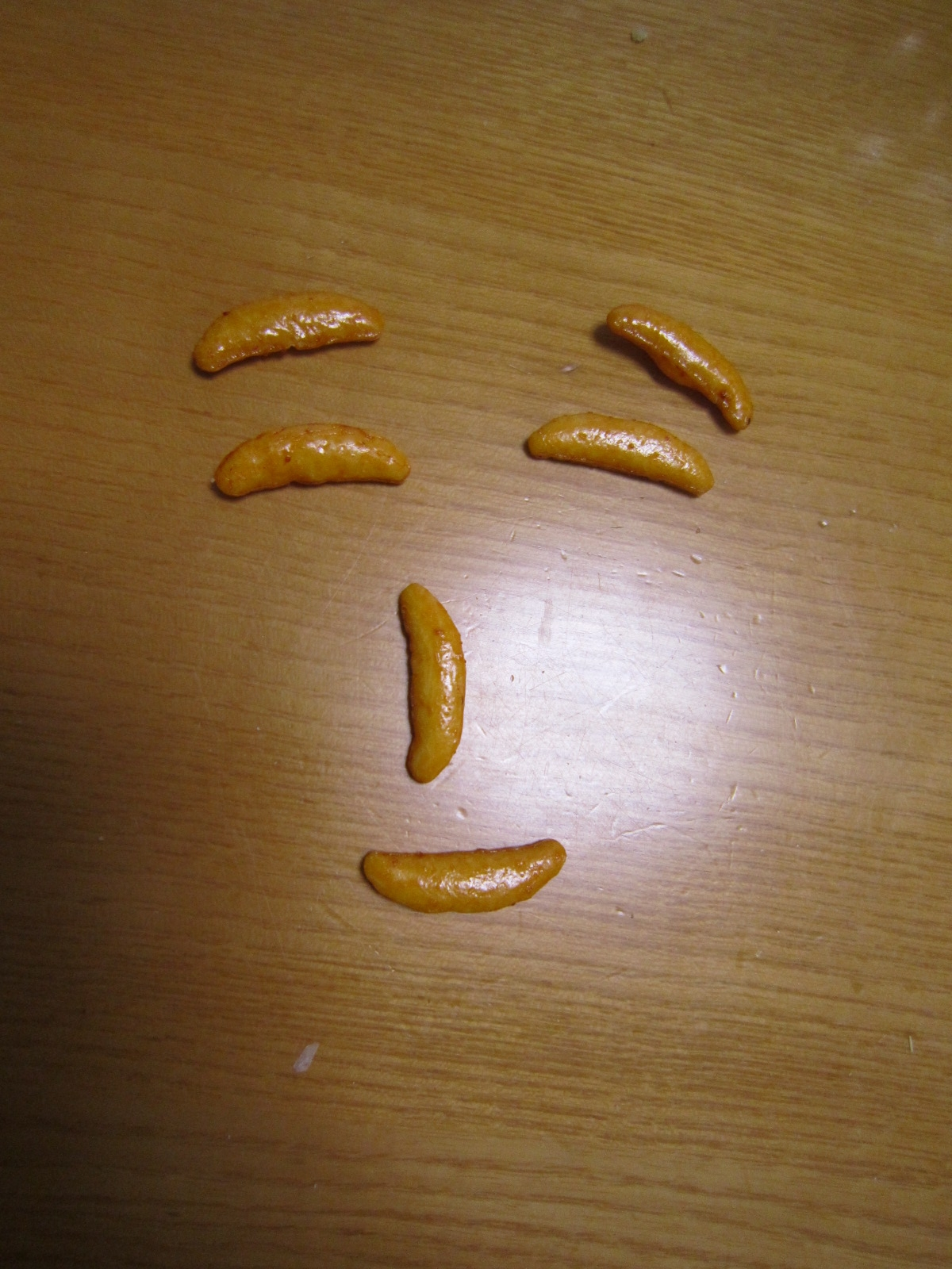 微笑む柿の種。