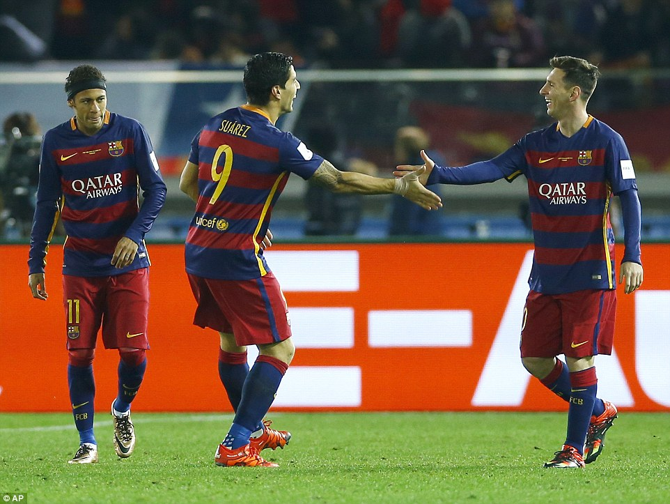Barcelona goalscorers Luis Suarez (centre) and Lionel Messi (right) celebrate with Neymar (left) during their 3-0 win over River Plate