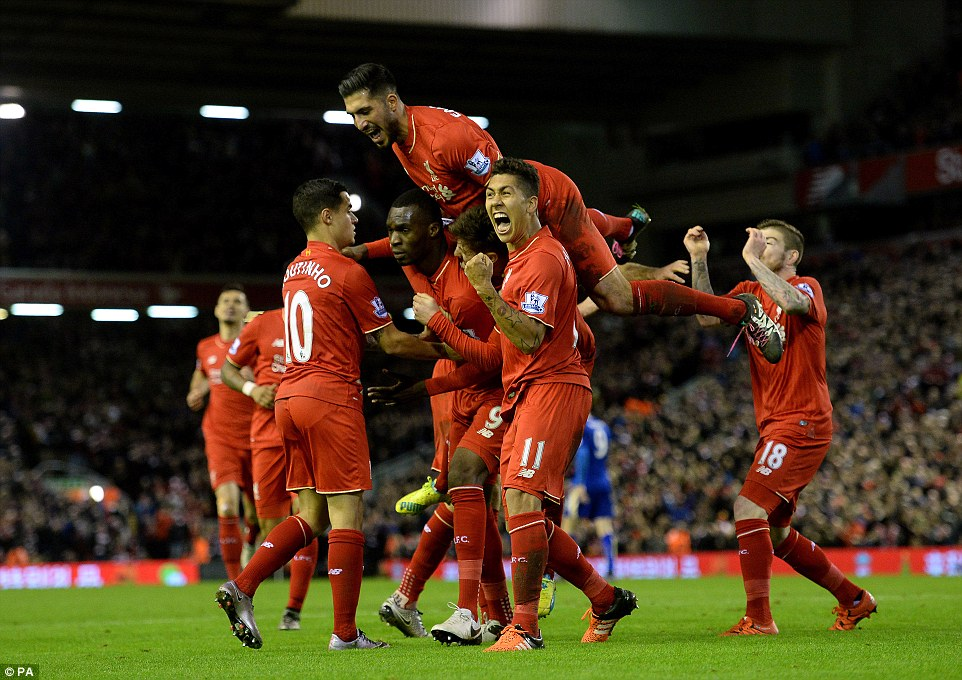 Liverpool striker (centre) was quickly mobbed by his team-mates after giving them the lead against the Foxes