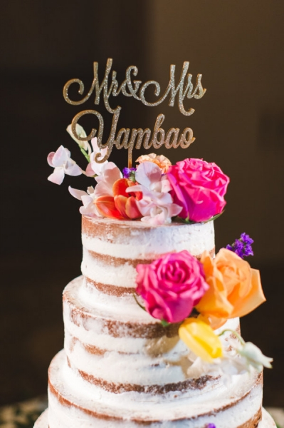 rustic-naked-wedding-cake-with-script-cake-toppers.jpg