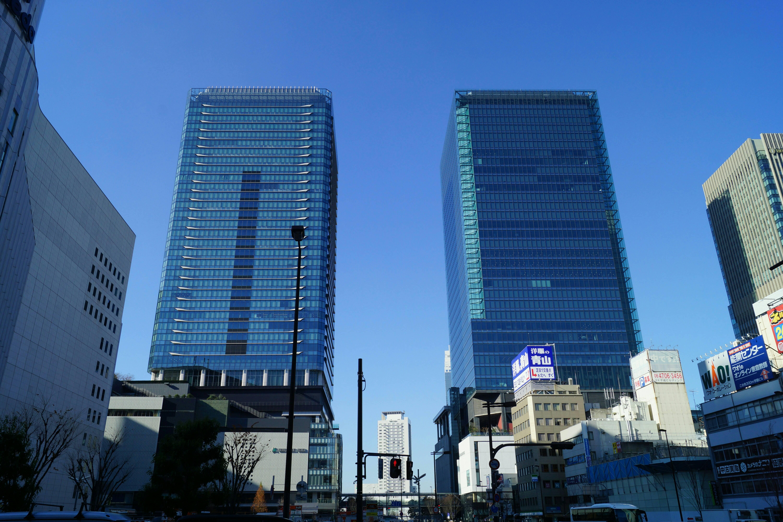 お知らせ - 超高層ビルと風景写...